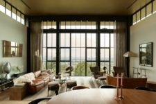 03 The living room has a glazed wall, there's quirky and catchy furniture of leather, metal and wood