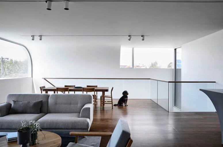 The main living space is an open plan raised up to enjoy the views of the neighborhood