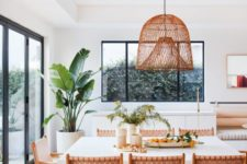 03 a Californian kitchen with a woven lamp, woven leather chairs and a large scale plant