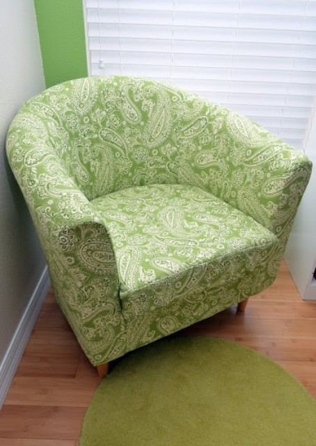 a reupholstered with bright botanical print fabric IKEA Tullsta chair is a bold idea and you can fit any fabric you like
