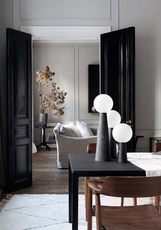 glossy black doors match the refined spaces and add more chic to them echoing with some black objects here