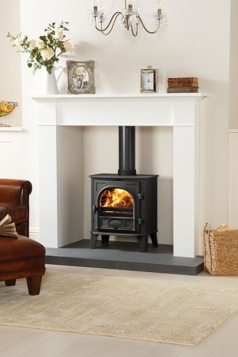 highlight your wood burning stove placing it into a niche with a concrete floor