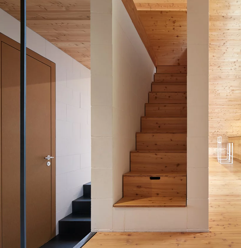 Soft and warm wood is compensated with colder materials like tiles and concrete