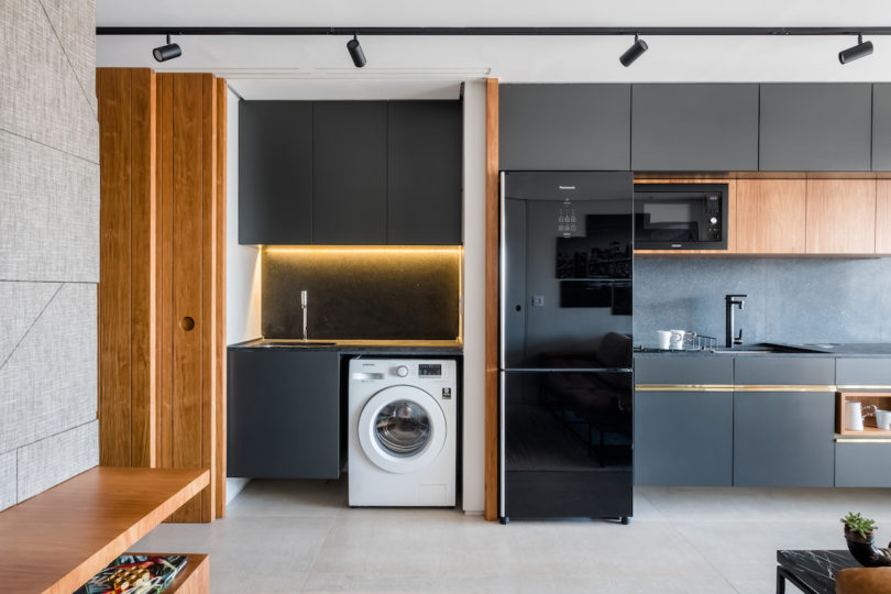 The storage and lights are built in and the kitchen can be hidden with sliding doors anytime