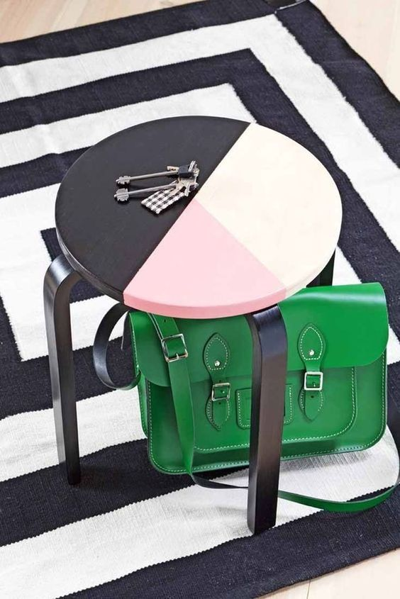 an IKEA Frosta stool painted with color blocking can double as a side table