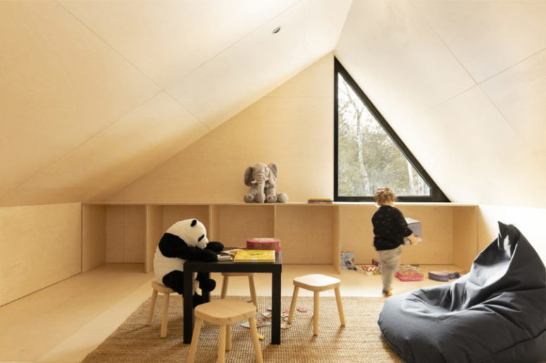 The upper, attic space, is given to the kid, it's a comfortable and cozy playspace with cool furniture