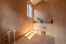 This peaceful corner fully done with plywood is a relaxation oasis for sure