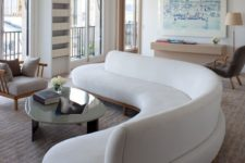 06 a gorgeous curved white sofa takes over the whole living room and adds soft lines and shapes to it