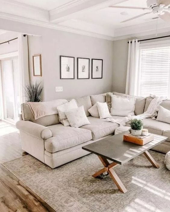 a neutral and stylish living room with a pattern and some texture infused with fabrics