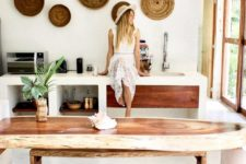06 a surf-shaped console table, tree stumps as stools and woven plates on the wall