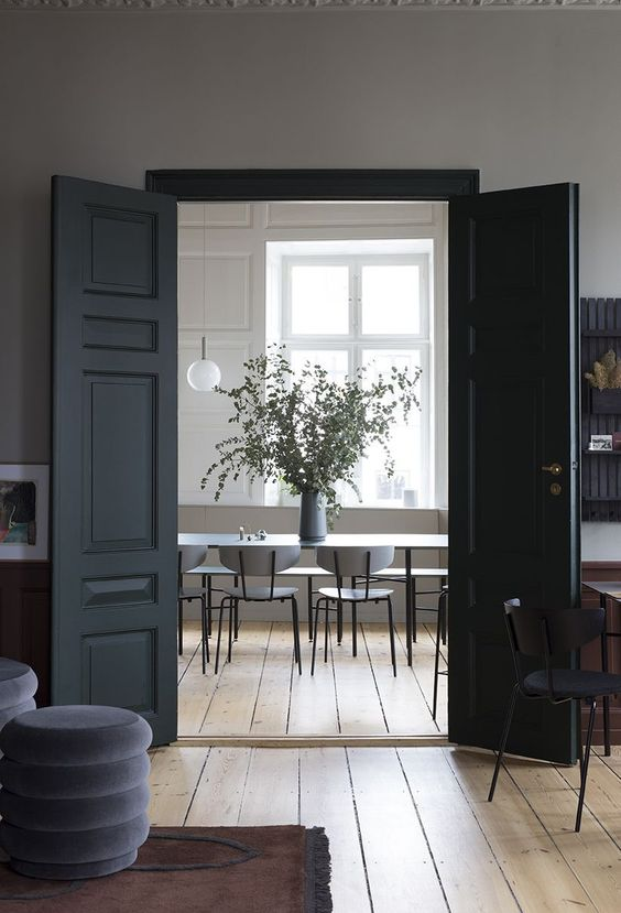 matte black doors like these ones are classics that will eaisly fit many spaces and will add instant drama to them