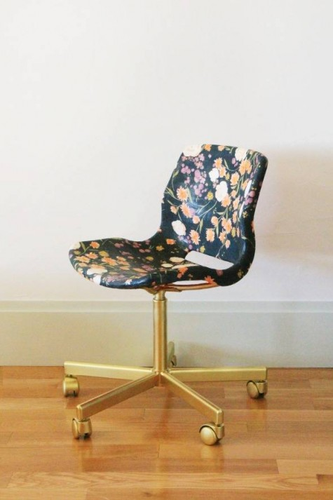 a basic IKEA office chair reupholstered with moody floral fabric and gold spray pinted base and legs