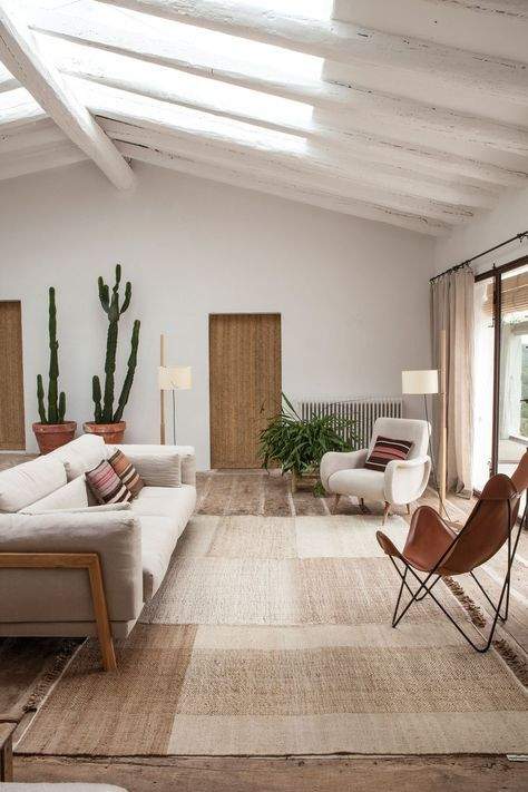 a natural color palette, some statement cacti in pots and natural light coming through skylights make the space cooler
