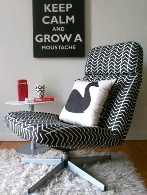 a comfortable IKEA Lunna chair reupholstered with graphic print black and white fabric and with a printed pillow