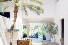 08 indoor trees in large planters create a feeling that you are alredy outdoors, and it feels so cool