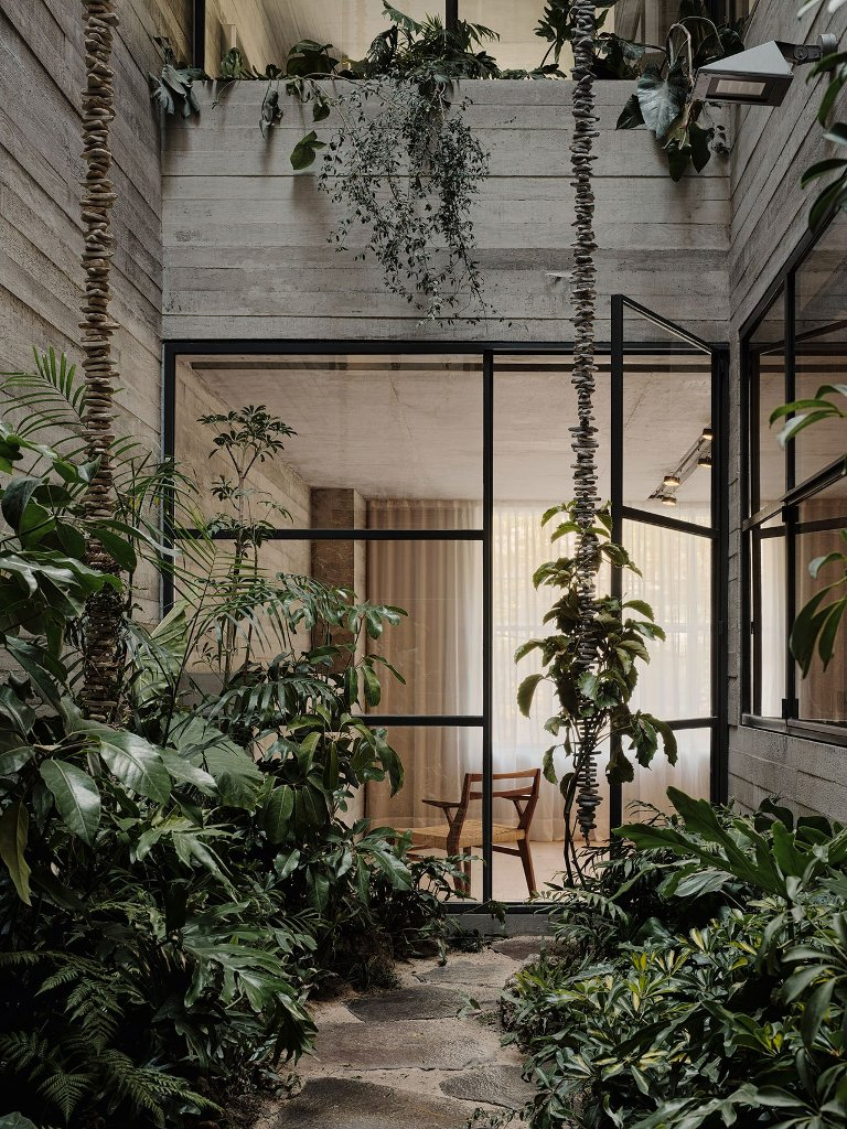 Inner courtyards enliven the indoor spaces with lush plants