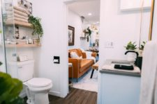 09 The bathroom is small yet functional, there's open shelving, a shower space and a sink