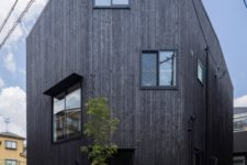09 The exterior of the house is clad with blackened wood, and you can see how irregular windows are positioned