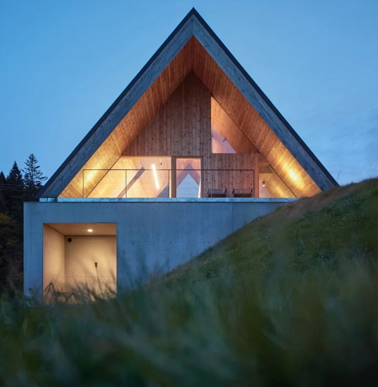 The house is built into a steep slope to erge with the landscape and keep the dwelling in hamony with the terrain
