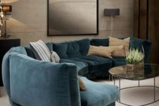 09 a moody refined living room with a curved teal sofa that adds color to the space and makes it bolder