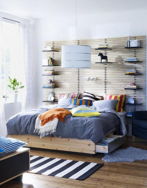 an IKEA Mandal headboard hacked with shelves for open storage is a very practical idea