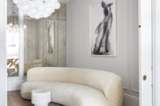 10 a neutral and refined space with a curved neutral sofa that catches an eye with its shape and adds a chic feel
