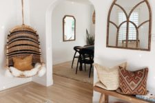10 printed pillows, a striped hanging chair and a printed rug make the entryway truly Californian-like