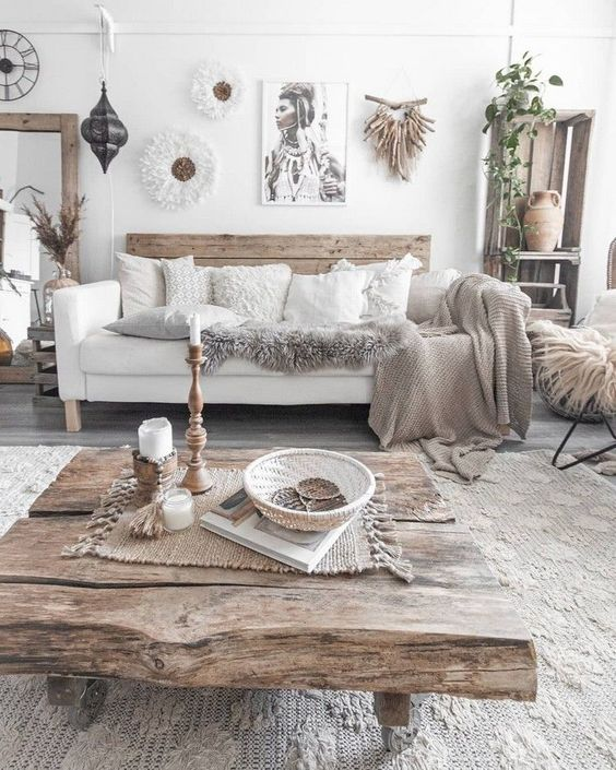 a boho living room with much wood, knit, crochet and jute that make up the whole style of this free spirited space
