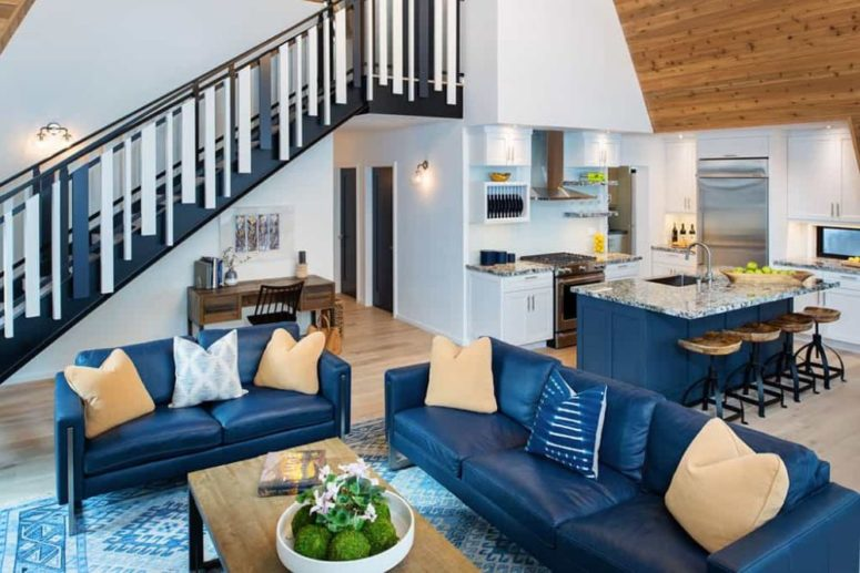 Various shades of blue are seamlessly incorporated into the decor, most notable on the ground floor