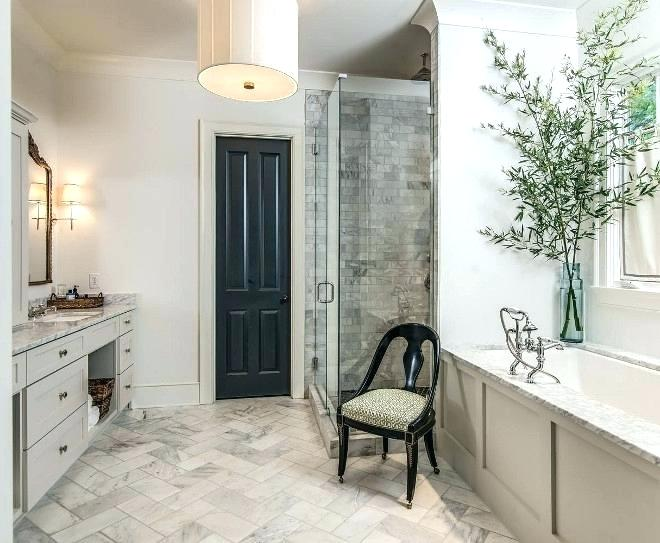 a single black door echoing a refined chair make a boring and traditional bathroom refined and catchy