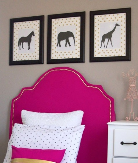 an IKEA Tarva bed with a bright pink upholstered headboard lined up with decorative nails