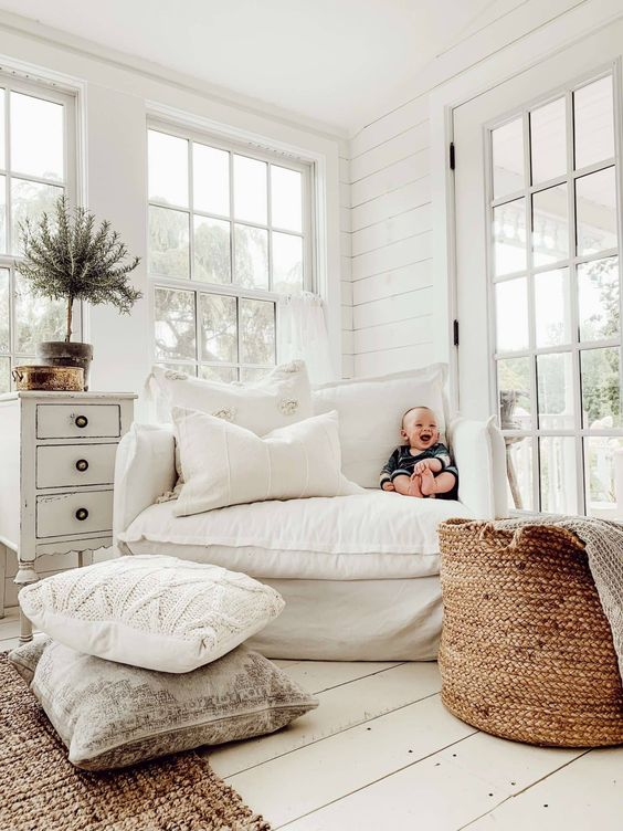 plenty of texture is added with various textiles, knits a jute rug and a basket for storage