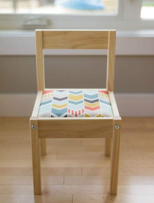 an IKEA Latt chair with a soft seat made of foam and bright printed fabric to make the piece more comfortable