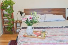 16 a bright bedroom with colorful bedding and a bold printed rug that give interest to the room