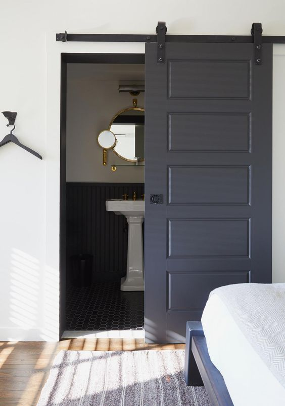 a graphite grey door won't have that much impact as a black one but it's still a bold and edgy solution to try