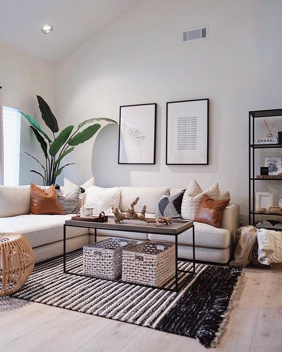 rugs, baskets and pillows of leather and crochet make the living room super chic and cool