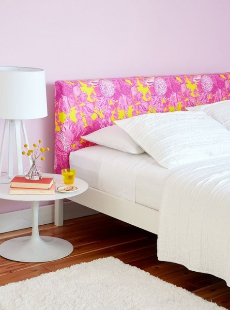 an IKEA Malm bed frame with a headboard hacked with colorful fabric for a touch of color