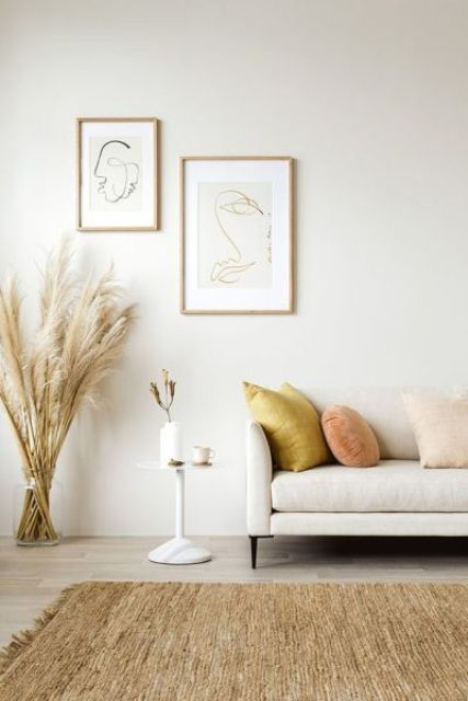 velvet throws, pampas grass and a jute rug make the living room super catchy and cool