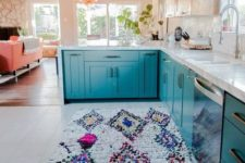 18 a bright printed rug and blue cabinets work well together giving the home a wild feel