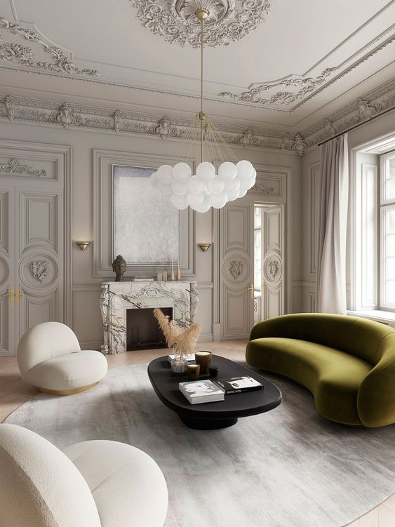 an exquisite room with an olive green curved sofa that adds color and catchy lines to the living room