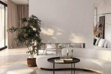 19 an elegant minimalist living room with a curved sofa and a matching footrest plus a black round coffee table