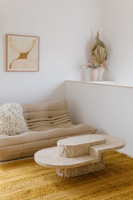 a quirky rounded coffee table adds eye-catchiness and a softer touch to the living room