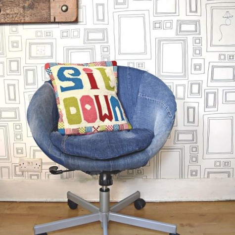 an IKEA Skruvsta chair renovated with some old denim and refreshed with a colorful pillow for a relaxed feel