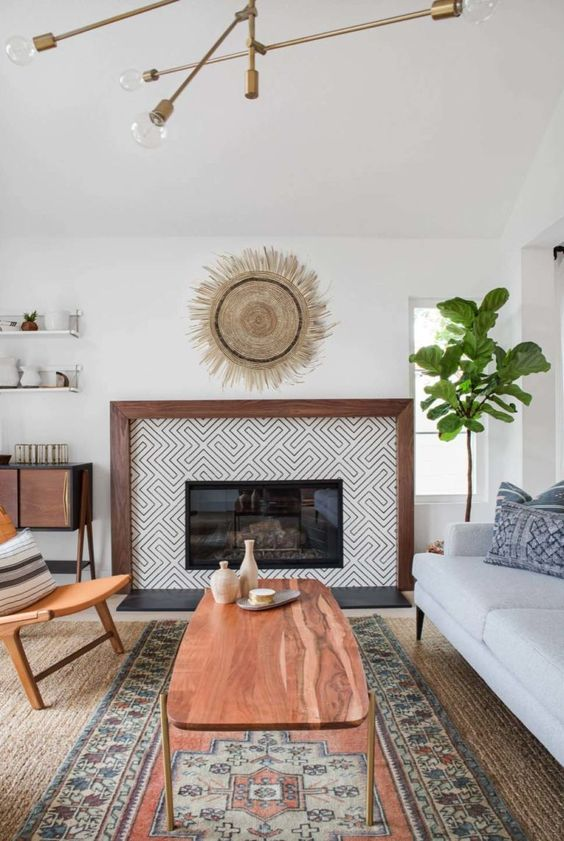 an eclectically styled living room with mid-century modern and boho items and furniture