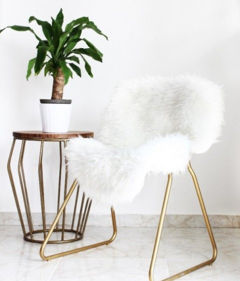 an IKEA Snille chair hack with gold spray paint and faux fur results is a very glam piece