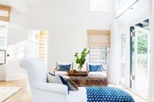 22 a dreamy Californian space with bold blue linens and touches of natural wood and jute