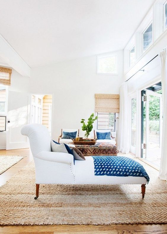 a dreamy Californian space with bold blue linens and touches of natural wood and jute