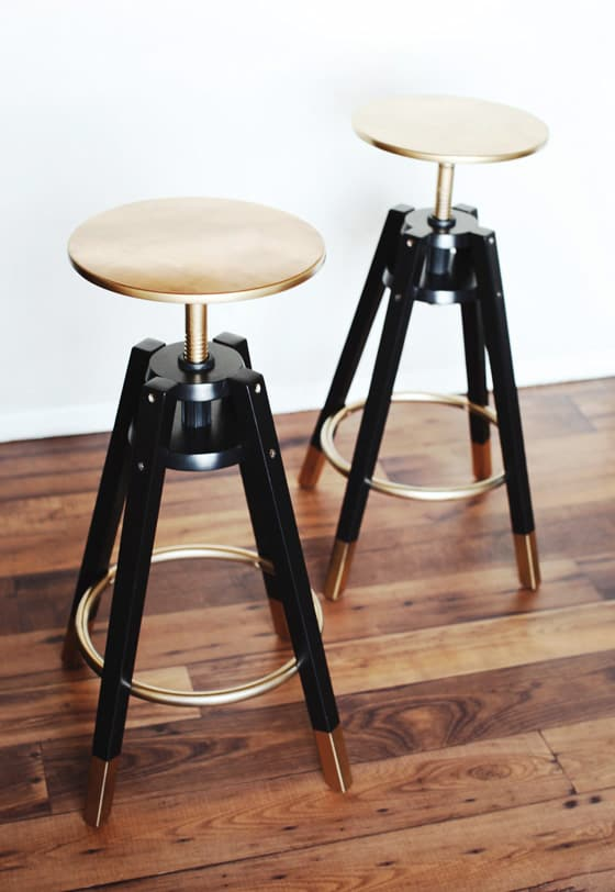 IKEA Dalfred stools hacked with gold and copper paint - jus tpaint some parts of them to make them bolder and more elegant
