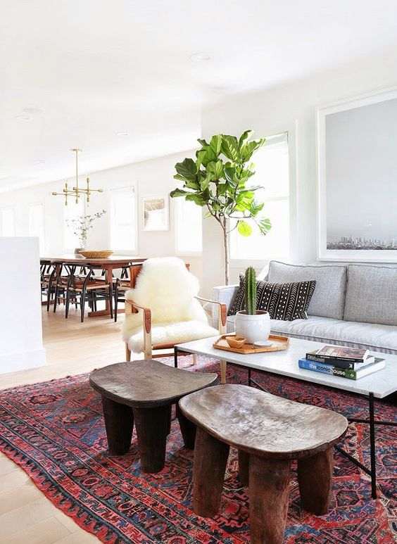layering, bold prints and natural materials plus mid-century modern furniture make this home feel Californian