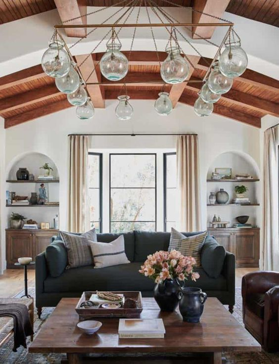 a living room with exposed wooden beams always looks cozy